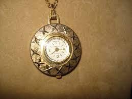 ine swiss made pendant watch