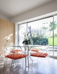 Clear acrylic furniture maximizes visual space creates a fresh