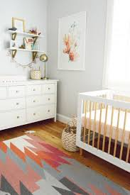 Love the abstract watercolor frame on the wall of this nursery