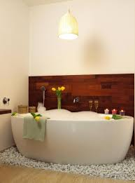 a deep bathtub allows greater immersion in the water than a traditional tub