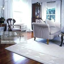 living rooms off white sculptured area rug walls wood floors traditional upholstered love seat beige mahogany rugs for hardwood floors