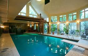 indoor pool house with diving board. Unique Board Full Sized Indoor Pool Features A Dive Board And Jump Platform Plus Sauna  Steam Rooms The House Opens To The Outdoor Grotto With Hot Tub Inside Indoor Pool House With Diving Board Montreal Gazette