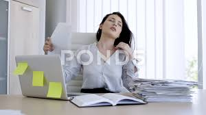 hot office pic. Attractive Woman In Very Hot Office Trying To Cool Down With Paper ~ Clip #76326712 Pic