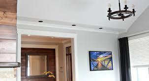 living room design with vaulted ceiling faux wood beam chandelier benjamin moore gray