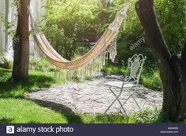 <b>Summer</b> garden with hanging <b>hammock</b> for relaxation. <b>Lazy</b> time ...