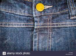 Worn Blue Denim Jeans Texture With Stitches And Button Abstract