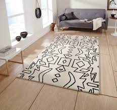 monochrome tribal 100 wool rug spectrum hand tufted