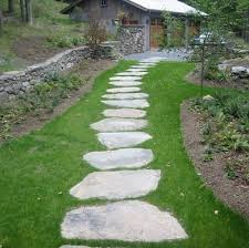 flagstone sidewalk ideas. large stones laid over grass form a casual, comfortable walkway leading through this yard to the garage. few diy ideas are as accessible for flagstone sidewalk
