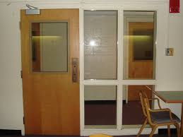 middlebury college replaced unsafe wired glass in and around this dormitory door with superlite i vision panel and superlite ii xl sidelites