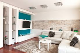 sofa table behind couch against wall. A Contemporary Living Room With Strip Of Stone Tile Inset As Shelf Into The Sofa Table Behind Couch Against Wall