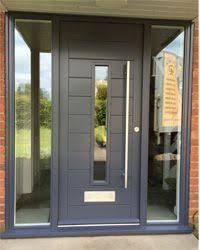 Door to complement Windows and cladding. Maybe not this exact one but  substantial, not