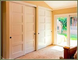 bypass sliding doors pass closet clean organized closets door track for cabinets