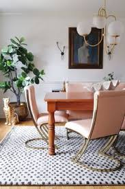 modern vine dining room pink and br cantilever chairs wood farmhouse table and the prettiest modern rug