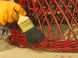 brush paint and varnish remover on wicker strands