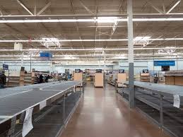 eerie photos of a walmart store on its last day of business reveal all in all the location was a far cry from the typical bustling walmart supercenter