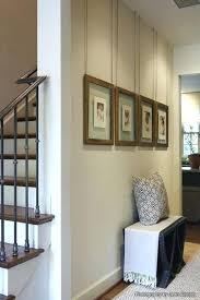 hanging picture frames in hallway by hanging it on a string ribbon rope it gives your pictures a totally hanging picture frames in hallway