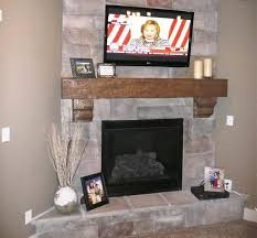 Stone Fireplace With TV  Stone On Fireplace With Tv Mounted Over Faux Stone Fireplace Mantel