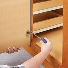 attach the new door using the existing holes in the cabinet face frame
