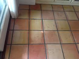 dirt embedded in saltillo tiles
