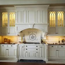 Elegant kitchen photo in Boston with multicolored backsplash, raised-panel  cabinets and beige cabinets