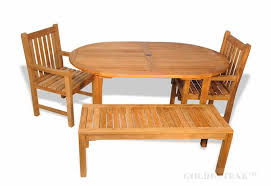 teak outdoor dining set oval table 2 benches two armchairs from goldenteak