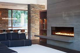modern gas fireplace inserts living room contemporary with black sectional sofa black sofa dark floor