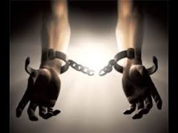 hands in shackles. flee the shackles and accept free gift of jesus christ! hands in