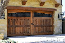 tuscan style garage doors custom handrafted in reclaimed barn wood rustic wooden garage doors