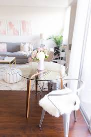 Adding small shag rugs to metal chairs gives a modern glamour to your dining  area!