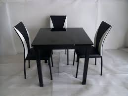 arctic white extending black glass dining table and 6 chairs round