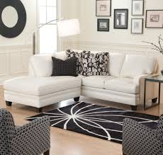 ... With Pillows And Lamp Stand And Then The Photo On The Wall Behind The  Couch And Carpet Floors With A Pattern Of White Lines Cute and small  apartment ...
