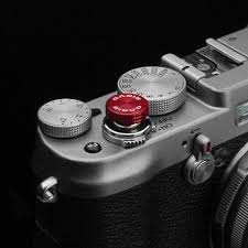 <b>Soft release buttons</b> for cameras made of high-quality material ...