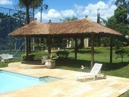 Ideally set on a large half acre lot with mature garden, trees and a large pool. Quiosques E Coberturas De Palha Sape Cobrire Construcoes Em Madeira Construcao Quiosque Retiro De Quintal