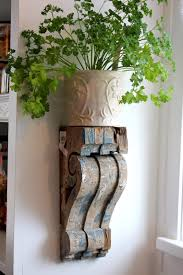 i contemplated making our own corbels when i came across a really neat photo of a rustic wooden corbel shelf on i instantly fell in love with