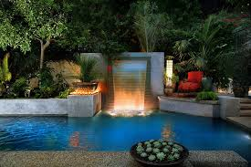 delightful backyard escape with pool waterfalls and ample greenery design estate pools