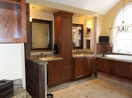 bathroom with wood cabinets and granite countertop capital stone saratoga in saratoga springs ny