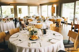 Round Table Settings For Weddings Wedding Dinner Table Setting Brown Chairs Stand At The