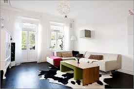 colorful living rooms with white walls. Black Cowhide Rug With White Wall Paint Colors For Elegant Living Room Colorful Rooms Walls