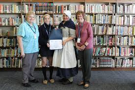 somerville student puts gps in the hands of christopher columbus essay winner carmela streicher history teacher joann fantina dar representative erica white and principal jean kline credits courtesy immaculata