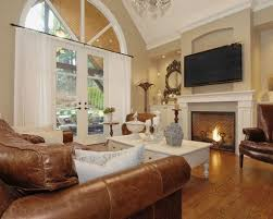 traditional family room designs. Brown Leather Sofa Set And Classic Fireplace Using Traditional Family Room Lighting Design With Ornate Framed Mirror Designs