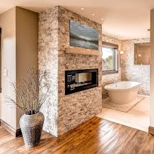 Bathroom:Master Bathroom Design With Wall Gas Fireplace And Round Shape  Frame Wall Mirror Ideas