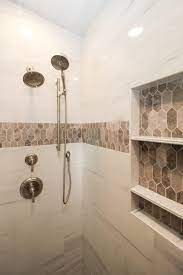 marble tiled shower walls with brown