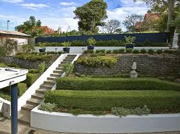 Small Picture garden design using bluestone with retaining wall hedging