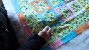 Quilting: How to tie a quilt using the