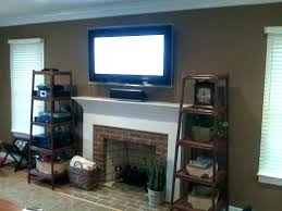 tv above fireplace hanging a flat screen over a gas fireplace hanging above gas fireplace above
