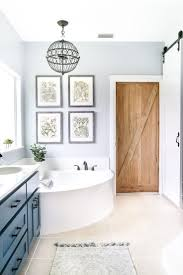 Small Bathroom With Alcove Bathtub Shower Combo And LimeStone Wall 4 Foot Tub Shower Combo