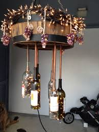 diy wine bottle chandelier outdoor barrel wine bottles bottoms cut off copper piping with ends to hold the wine bottles on lights