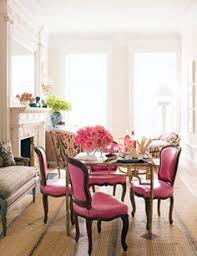 bright pink living room in the middle of the long narrow living room which designer jonathan berger broke down into three seating areas