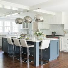 blue kitchen island with mercury glass pendant lights