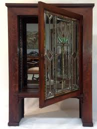 sold antique craftsman cabinet with stained glass door